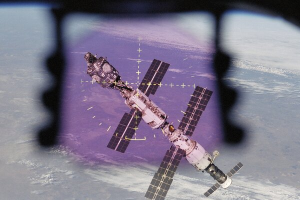 The International Space Station viewed from the Space Shuttle Atlantis's crew optical alignment system for undocking in September 2000.