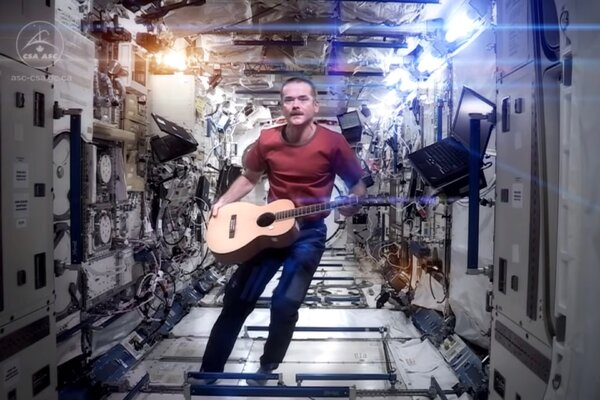 """Chris Hadfield delivering his rendition of David Bowie's """"A Space Oddity"""" in 2013."""