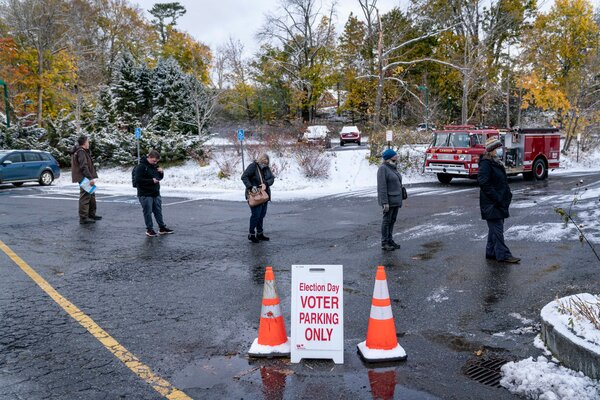 Voters line up before the polls opened in Camden, Maine, on Tuesday.