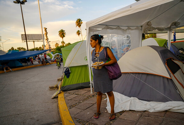 Angelica Xolxol, 25, from Alta Verapaz, Guatemala and six months pregnant, received a handout meal at a tent camp near the international bridge in Matamoros.