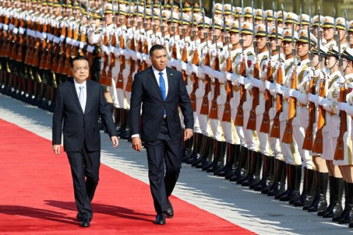 Prime Minister Andrew Holness of Jamaica, right, meeting with China's premier, Li Keqiang, in Beijing last year. Jamaica has received more Chinese government loans than any other Caribbean island nation.