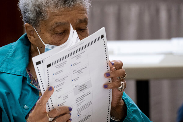 An election official sorting ballots during an audit in Rome, Ga. on Friday.