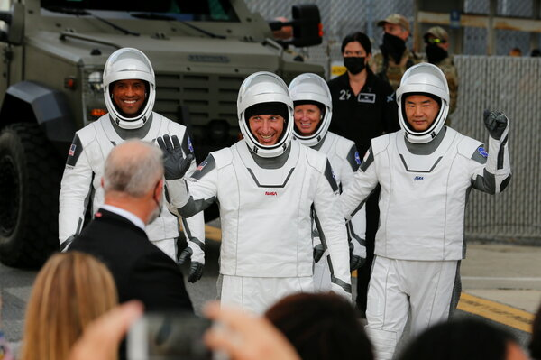 The astronauts flying on SpaceX's Crew-1 flight to the space station on Sunday before they set out for the launchpad.