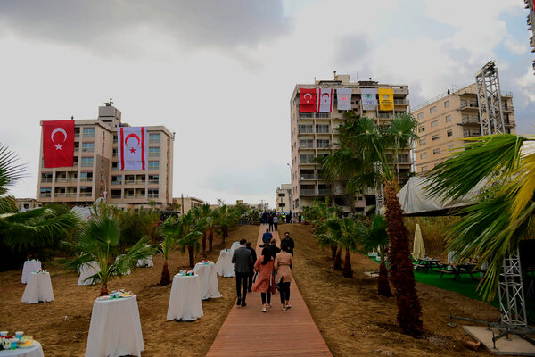 Abandoned buildings were adorned with Turkish and Turkish-Cypriot flags in Varosha, in Cyrpus's north, ahead of Mr. Erdogan's visit.