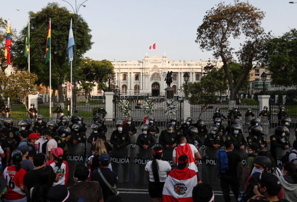 The police stood guard in front of Peru's Congress in Lima after interim President Manuel Merino announced his resignation on Sunday.