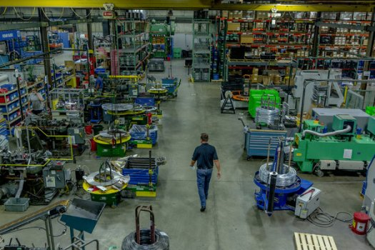 A Michigan manufacturer. The U.S. economy scrambled back in the summer, and growth rose 7 percent from the previous quarter. But now a new surge in cases threatens that recovery.
