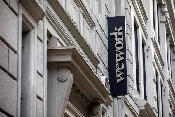 WeWork leases space in office buildings and then charges freelancers, start-ups and large companies to use it.