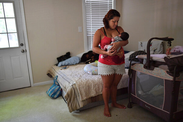 Lisbeth, 29, holding her 8-day-old daughter at a shelter in Austin, Texas, came to the United States from El Salvador.