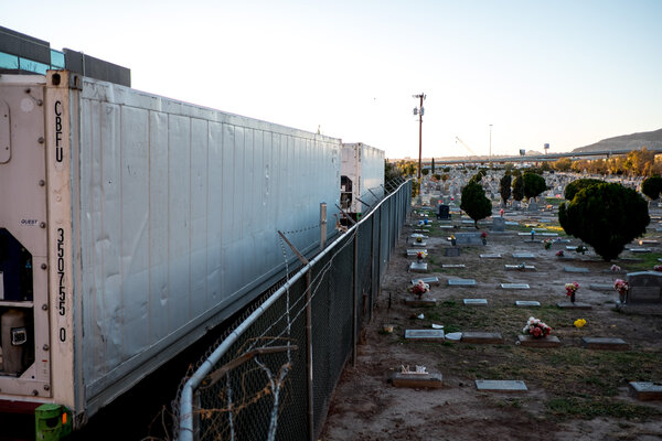 Refrigerated temporary morgue trailers parked next to a cemetery in El Paso last week.