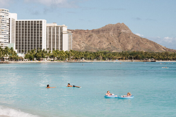 Waikiki beach is seeing far fewer tourists during the coronavirus pandemic.
