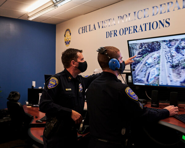 Capt. Don Redmond, left, and Officer Evan Linney monitoring a police drone operation from the Chula Vista Police Department's command center.