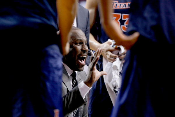 Cal State Fullerton coach Dedrique Taylor, here with his players in 2018, has put the season on hold as the team quarantines after a player tested positive.