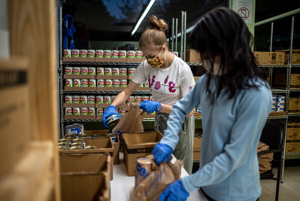 Volunteers at the food pantry in Houston. Undocumented immigrant parents are eschewing programs like food stamps that their citizen children clearly qualify for and are instead flocking to food pantries.
