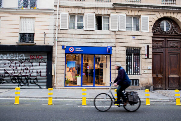 """A street in the Marais neighborhood of Paris, deserted because of a lockdown. """"Nonessential"""" stores are closed until Saturday, so the country has delayed Black Friday a week."""