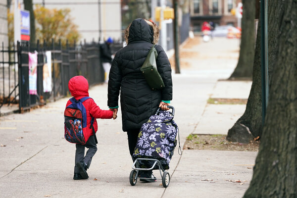 A young student being walked to P.S. 91, the Albany Avenue School in Brooklyn, earlier this month. Public school enrollment is down in New York City.