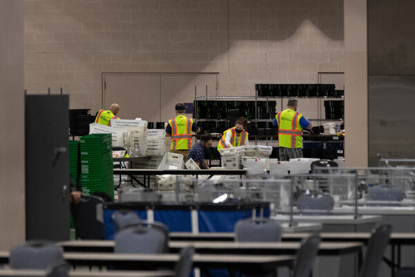 Election workers perform in the ballot counting area at the Pennsylvania Convention Center in Philadelphia on Friday.