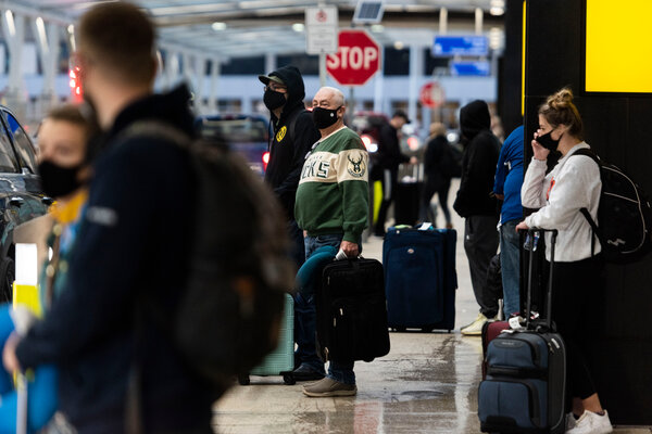 General Mitchell International Airport in Milwaukee, Wis., on Wednesday. Despite strong warnings from the C.D.C., millions of Americans opted to travel for the Thanksgiving holiday by plane or by car.