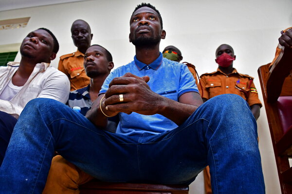 Robert Ssentamu Kyagulanyi, center, also known as Bobi Wine, appears in court in Iganga, Uganda, last week. Mr. Wine is running for president of Uganda and as an opposition candidate has faced intense intimidation.