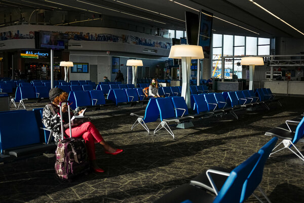 Thanksgiving travelers at LaGuardia Airport on Wednesday.