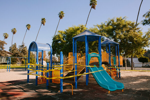 A closed playground in Los Angeles, where many people are weary after nine months of shifting rules.