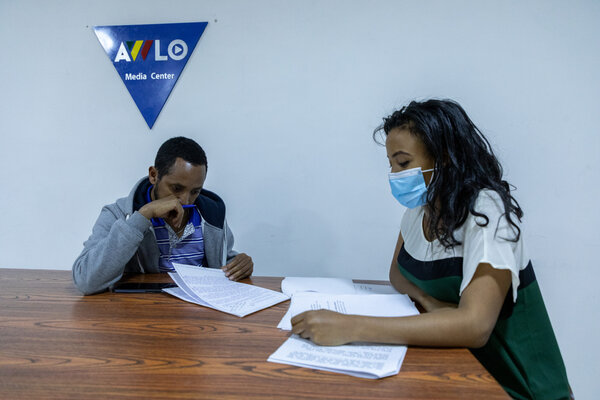 Woldegiorgis Ghebrehiwot, left, and Trhas Atsbeha, both journalists, working at Awlo Media. The company's offices were raided by the authorities last month.