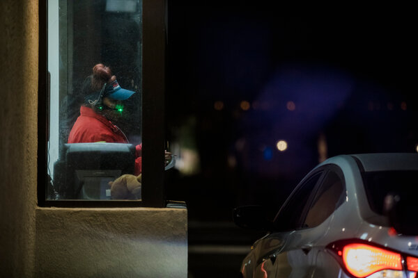 The drive-through window at a fast food restaurant in Albuquerque. Food service workers have high rates of infection from the coronavirus.