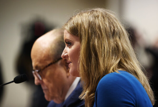 Jenna Ellis and Rudolph W. Giuliani, members of President Trump's legal team, appearing before the Michigan House Oversight Committee in Lansing, Mich., last week.