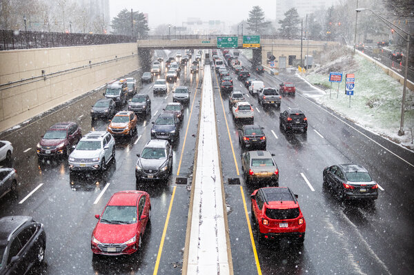 Traffic and snow along the Vine Street Expressway in Philadelphia on Wednesday.