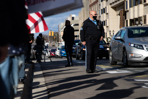 The police monitored a protest in Lansing, Mich., last month. Law enforcement officers are especially susceptible to contracting the coronavirus.