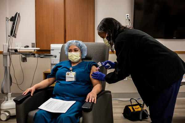 The Moderna Covid-19 vaccine arrived at sites across the country Monday. Yanitza Reeves, a medical worker, received one of the first doses at Christ Hospital in Jersey City, N.J.