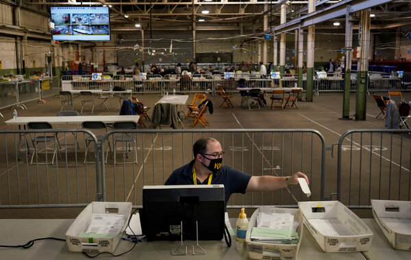 An election board worker in Pittsburgh processed mail-in and absentee ballots on Nov. 12. A federal judge on Saturday dismissed a lawsuit by the Trump campaign that argued there were widespread improprieties with mail-in ballots.