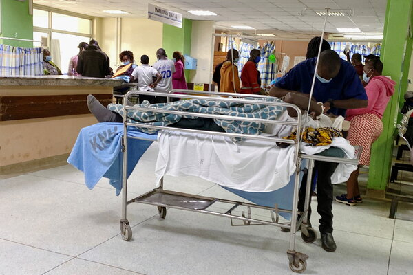 A relative attended to a patient at Kenyatta National Hospital in Nairobi, Kenya, on Monday as doctors across the country went on strike.