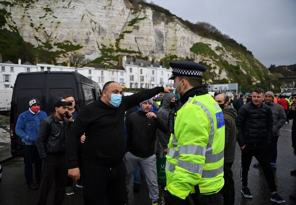 Truck drivers and others argued with police officers in Dover, England, on Wednesday. About 4,000 Europe-bound truck were stuck this week after France closed its border.