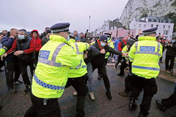 Truck drivers scuffled with police officers at the entrance to the port of Dover, England, on Wednesday.