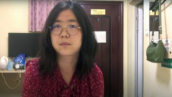 Ms. Zhang in a video from her hotel room that she posted on YouTube. The unfiltered information she shared about the epidemic in her videos went against the government's victorious narrative.