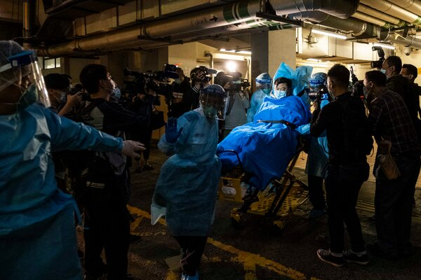 Paramedics transporting the first person to test positive for the coronavirus in Hong Kong on Jan. 22.