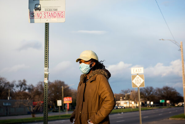 Valerie Brown waited for the No. 17 bus in April to get home after work in Detroit.
