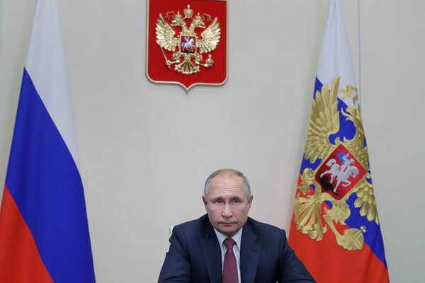 "President Vladimir V. Putin outside Moscow on Wednesday. He lamented that a ""dangerous new virus has turned upside down our usual life, work and study,"" in his New Year's address."