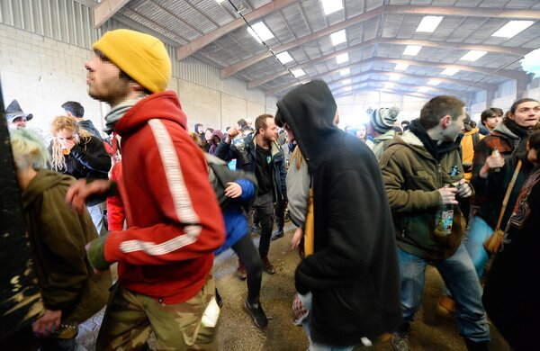 Some of the estimated 2,500 partiers dancing at a New Year's Eve rave held in a disused hangar near Rennes, France. The party was still going on Friday morning.