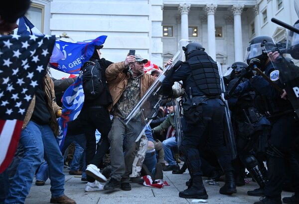 Trump supporters clashing with the police as they stormed the Capitol.