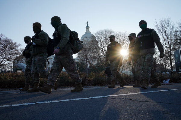 The National Guard patrolling the perimeter of the Capitol Thursday morning.