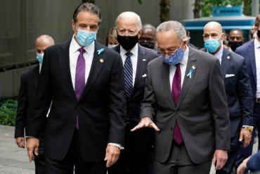 Gov. Andrew Cuomo, left, has a better relationship with President-elect Joseph Biden Jr., center, than he does with Mr. Schumer, right.