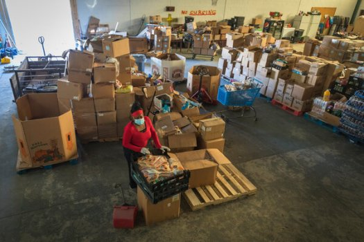 The Royal Divinity Food Bank in Birmingham, Ala., says it has been feeding hundreds more families each month since the pandemic began. The job market has improved, but millions remain unemployed.