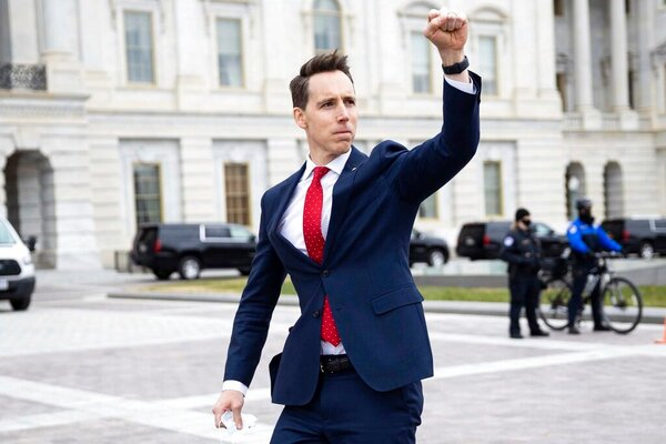 Senator Josh Hawley, Republican of Missouri, acknowledged supporters of President Trump outside the U.S. Capitol on Wednesday. Mr. Hawley was one of several senators who challenged the election results.