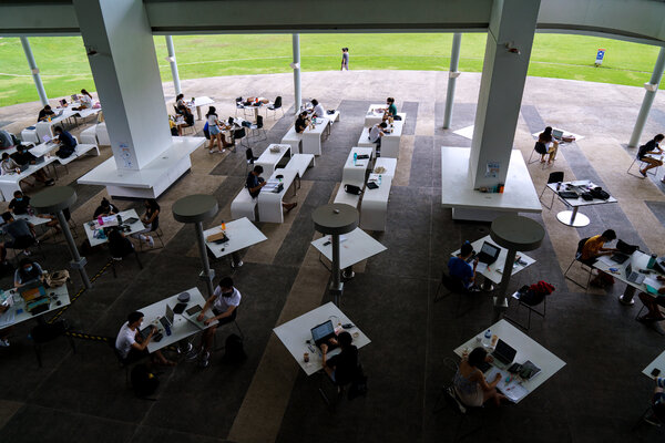 Students and staff at the National University of Singapore move within their designated zones on campus in November. Universities in Singapore have avoided coronavirus cases in part by using technology.