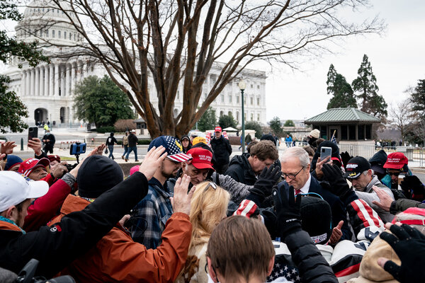 Supporters of President Trump prayed for Senator Kevin Cramer, Republican of North Dakota, after questioning why he wouldn't vote to object to Electoral College votes from some states.