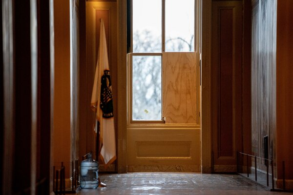 A window is boarded up in a hallway of the U.S. Capitol Building in Washington on Friday. President Trump's role in inspiring the mob violence had prompted many Democrats to support investigations into Trump and his aides.