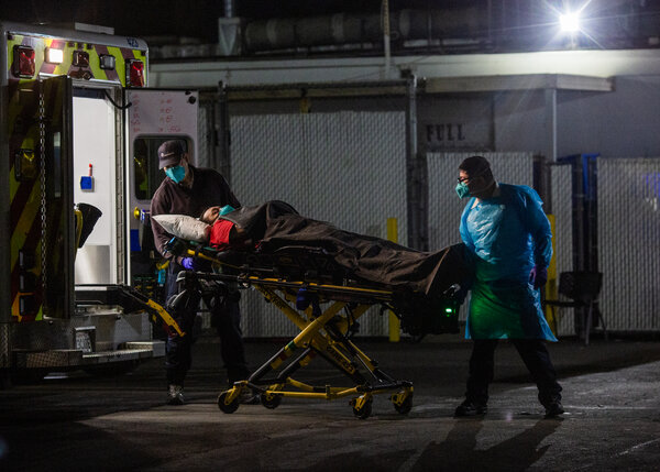 A patient arriving at Community Hospital of Huntington Park in Los Angeles on Sunday night.