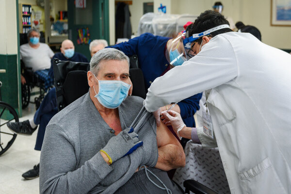 James Ivialiotis received his second dose of a Covid-19 vaccine at a nursing home on Staten Island, N.Y., on Monday.