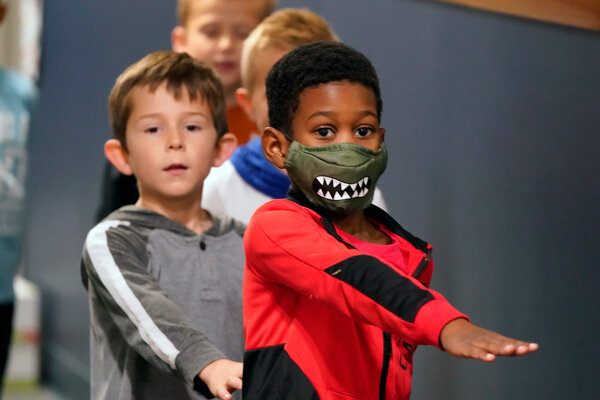 Students in Murphy, Texas. Young children are less likely to be infected by the coronavirus, new research confirmed.